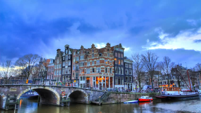 Beautiful Full HD timelapse of the corner of the 'prinsengracht' and 'brouwersgracht', canals in Amsterdam, just after sunset in winter. The Amsterdam canals are on the UNESCO World Heritage list