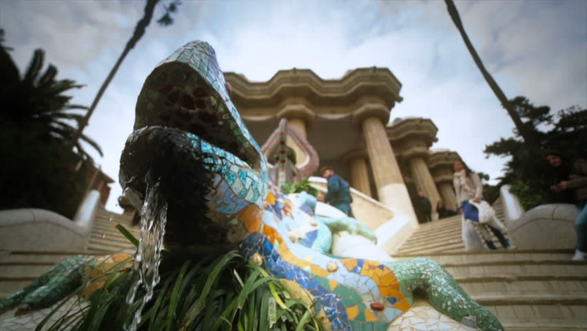 SPAIN, BARCELONA - CIRCA JANUARY 2013 Fountain of a salamander made of colorful mosaics in the Parc Güell. | Shutterstock HD Video #3369881