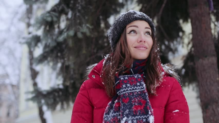 809648d6119 Portrait young beautiful woman standing on the street falls snow smiles  christmas snowball winter young beautiful girl happiness joy outdoor  throwing white ...