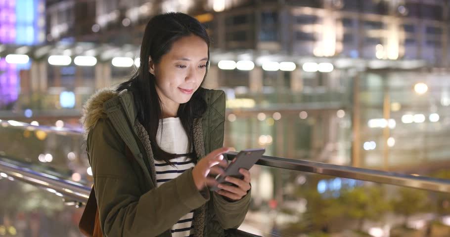 Young Woman use of smart phone in Hong Kong | Shutterstock HD Video #33712996