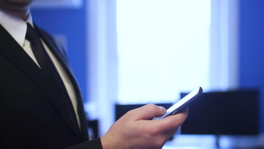 Businessman using smartphone in office | Shutterstock HD Video #33720178