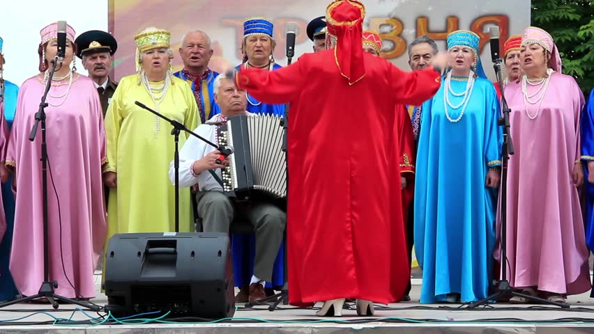 KIEV, UKRAINE, MAY 9, 2012: Holiday concert dedicated to the 67th Anniversary of victory in Great Patriotic War(World War II). Women in coloured costume sing Ukrainian song, Kiev, Ukraine, May 9, 2012