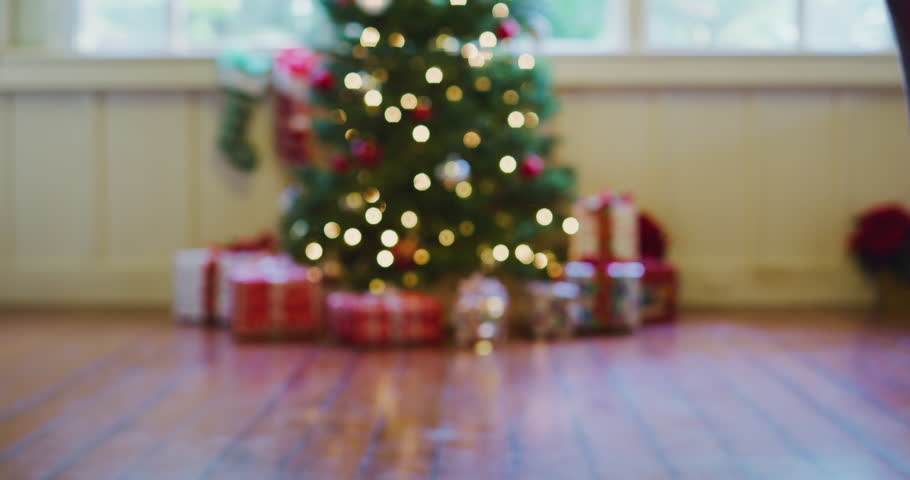 Happy young kids running to Christmas tree to open presents on Christmas morning   Shutterstock HD Video #33820408