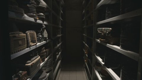 Storage shelf in historical archive opening sequence