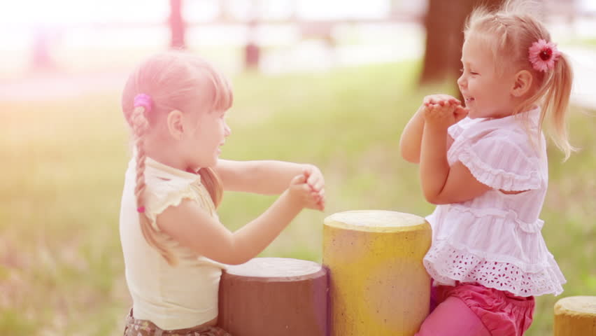 Sunny girls outdoors.Children playing in the Kids Count. Slow motion