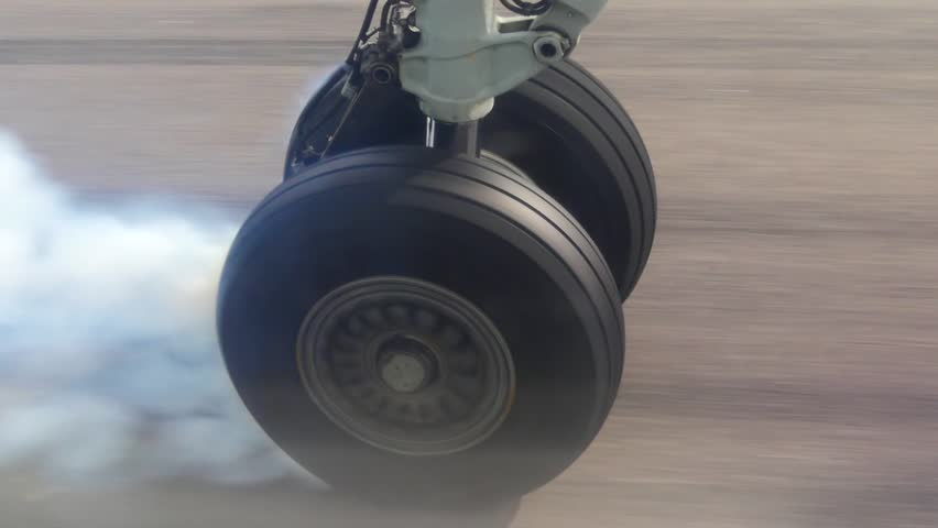 View on airplane wheel at landing, close up shot | Shutterstock HD Video #33838258