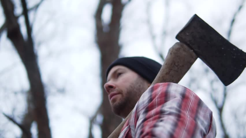 Cinematic Lumberjack Man, Strength And Dedication, Outdoor Snow Slow Motion. Authentic Candid Heroic Looking Low Angle.