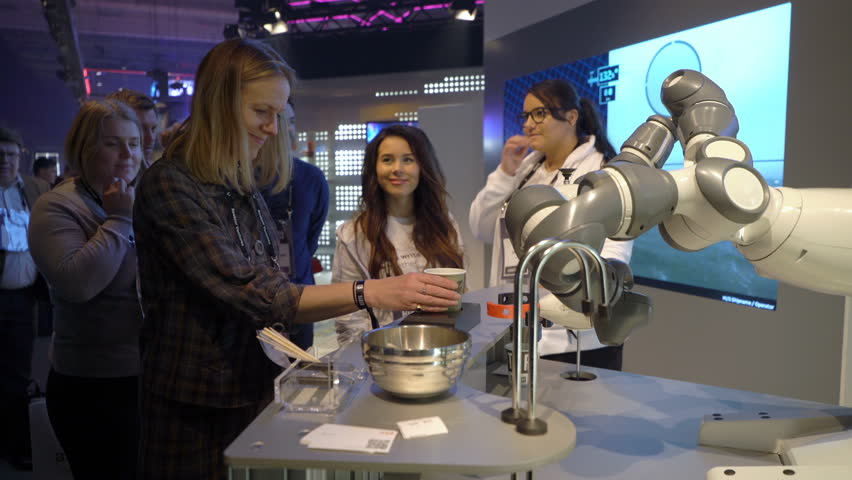 HELSINKI, FINLAND - NOVEMBER 30, 2017: Robot with flexible hands makes a coffee. Startup and tech event Slush in Messukeskus Expo center. Non-profit event for entrepreneurs, investors, students.
