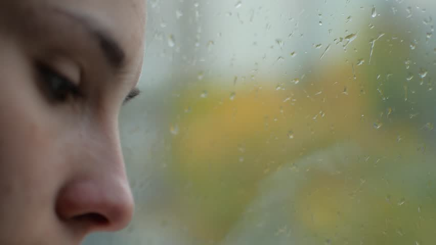 A woman with a cold runs near the window. The girl is sick and sniffs into the napkin | Shutterstock HD Video #33853288