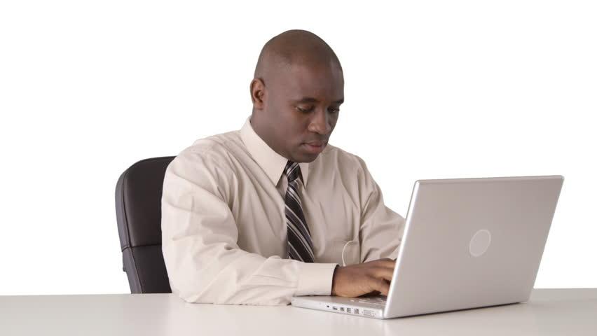 African American Businessman secretly listening to music at desk | Shutterstock HD Video #3389378