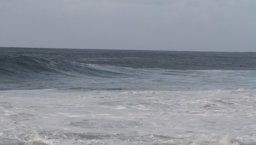 Really big waves break at Pipeline on the north shore of Oahu in Hawaii. These breakers are close to 20 feet tall