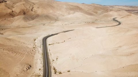 Desert road - Aerial footage of a new two lane road surrounded by dry desert landscape