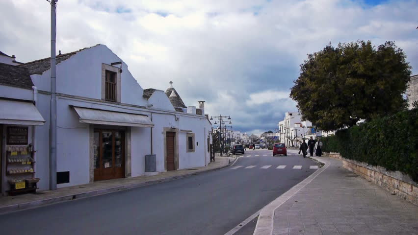 ALBEROBELLO, ITALY - DEC 18: Trulli - traditional Apulia stone roof houses on December, 18, 2013, Alberobello, Italy. Alberobello is UNESCO World Heritage Site highly visited all year round