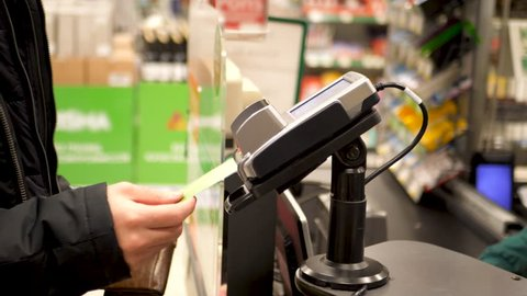 Hand entering pin code at grocery store or supermarket cash register. 4K UHD