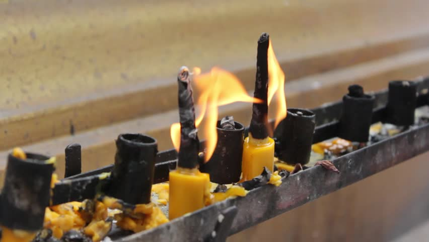 Candle flame close-up in the Thailand Temple | Shutterstock HD Video #33972448