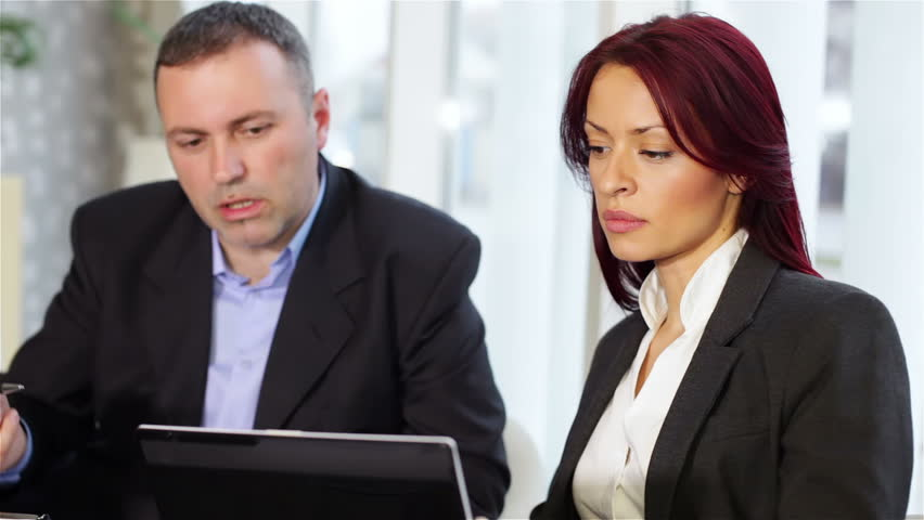 Business people discussing in a meeting. Shallow depth of field. | Shutterstock HD Video #3397688