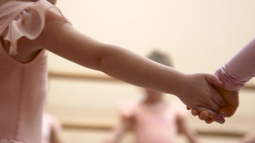 Little girls dance ballet. Children in ballet class