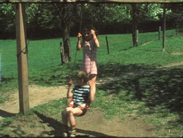 Vintage 8 mm film: Children on playground