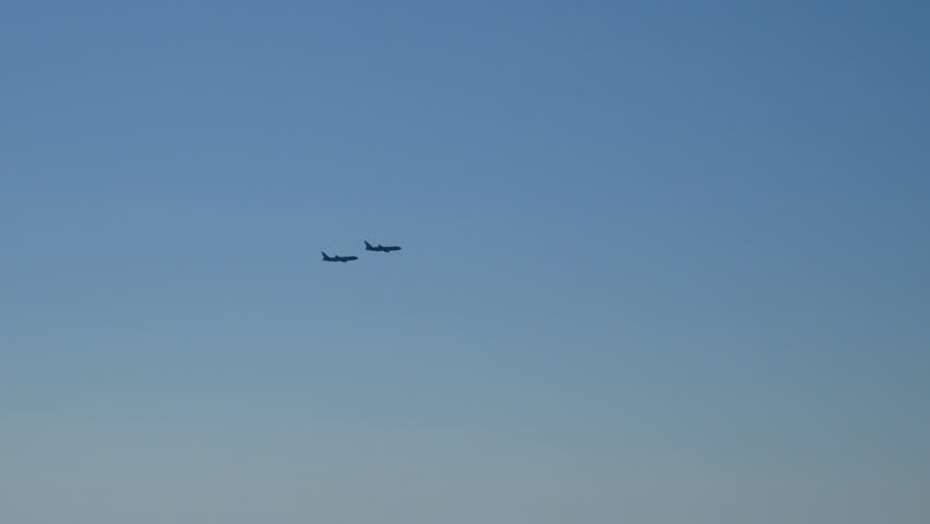 couple of fighter military airplane flying silhouette