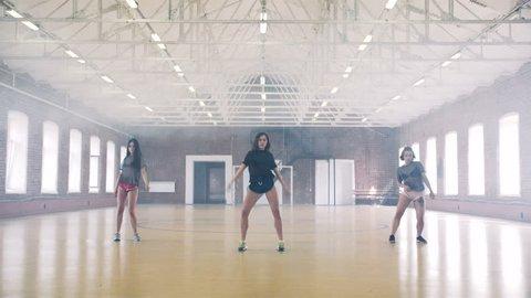 Three girls twerking in sport gym