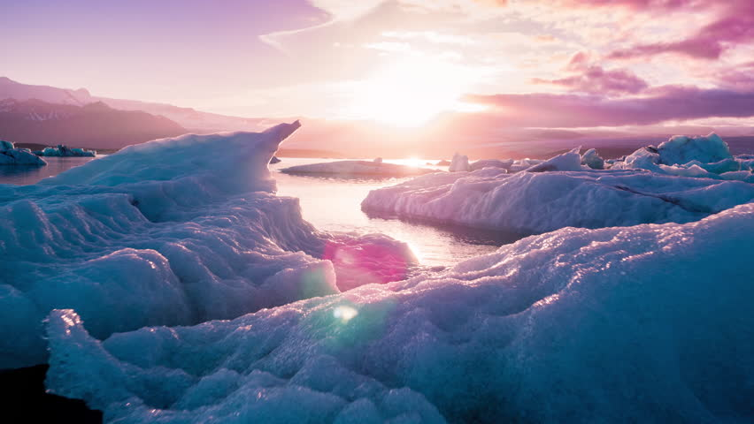 Aerial Drone Flight Over Glaciers Particles Floating In Glacial Lake Sunset Colors Ice Caps Iceland Exploration | Shutterstock HD Video #34065538
