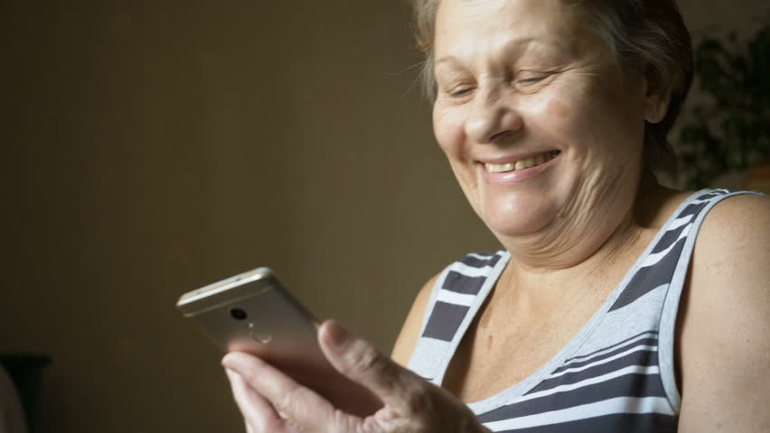 Old woman using new smartphone. | Shutterstock HD Video #34075408