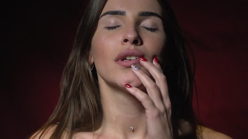 Beautiful brunette feels pleasure, orgasm. Slow motion shooting
