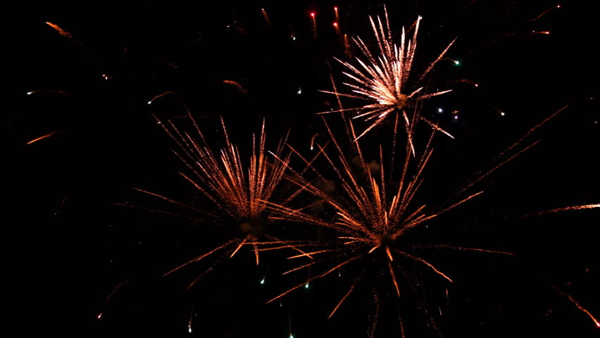 Fireworks exploding in various colors in the dark night sky during a celebration. | Shutterstock HD Video #34130758