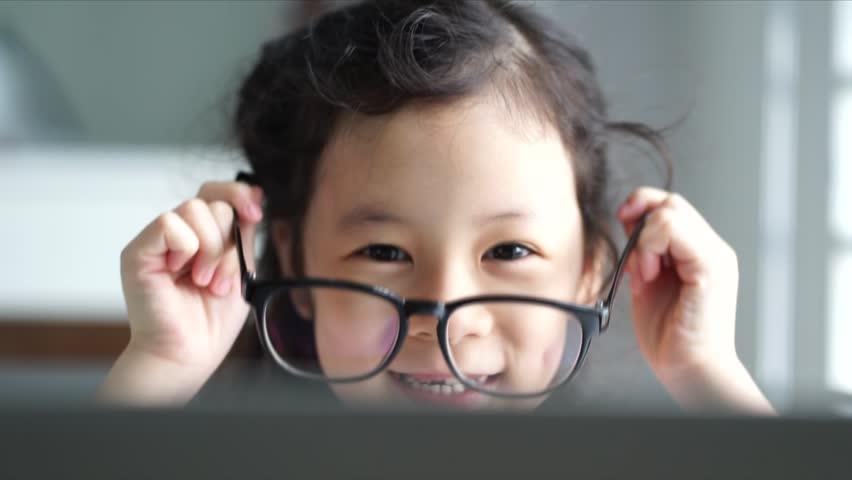 Little girl first time wear glasses | Shutterstock HD Video #34147348