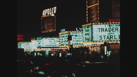 NEW YORK, 1971, 42nd Street movie marquees, Times Square at night, traffic