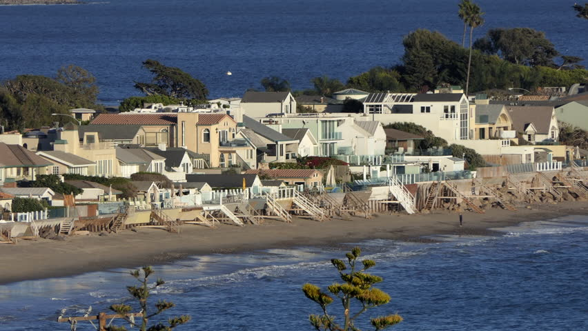 Beach front homes with Red Tailed Hawk in the exclusive Malibu Colony area near Los Angeles, California.