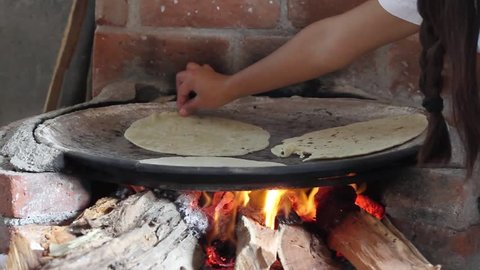Making tortillas with comal