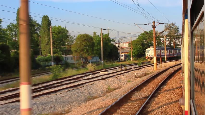 Suburbans train railways. Shot from window with wide lens.