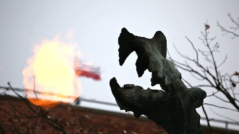 KRAKOW, POLAND - DECEMBER 2017; Sculpture of the Wawel Dragon at the foot of Wawel Castle.