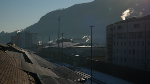 Winter Smoky Chimney. Roof in Chiasso, near Railway Border