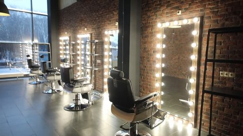 Movement along the chairs and mirrors to the window in the barbershop