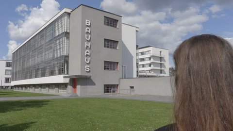 Dessau-Rosslau / Germany - 09.05.2017:Girl is taking instax photo of the Bauhaus building.