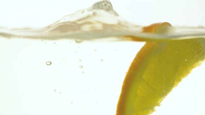 Orange slice falling into water on white background slow motion close up full hd video. Water surface with floating cutting citrus fruit, splash bubbles and waves #34401268