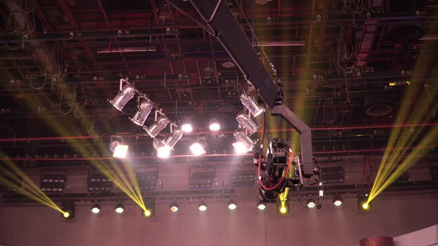 Digital broadcasting studio, camera JIB crane, lighting, mixer and equipment in studio. | Shutterstock HD Video #34414048