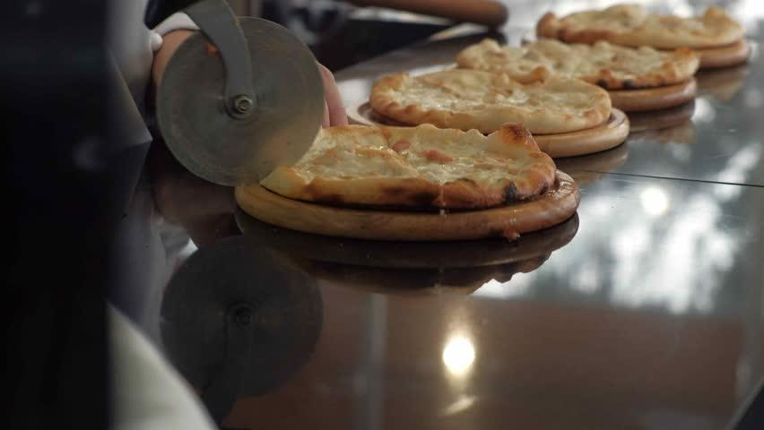 Chef cooks pizza at the restaurant 4k