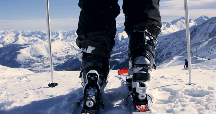 Skier Attaching Ski Boots And Skiing - Back View 4K | Shutterstock HD Video #34422598
