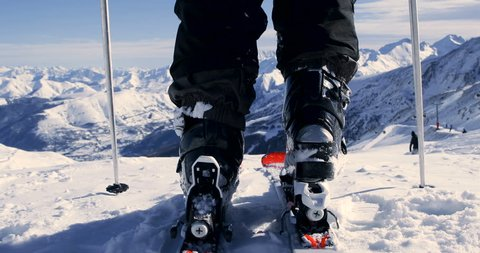 Skier Attaching Ski Boots And Skiing - Back View 4K