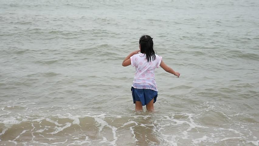 Beautiful Asian girl lying on the breach slow motion 4 | Shutterstock HD Video #34434688