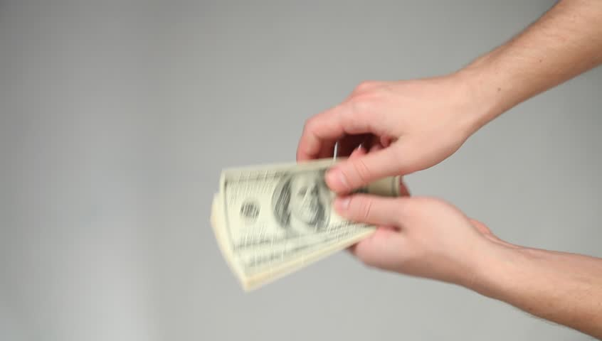 Hands giving and taking dollars on grey background