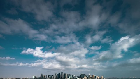 Doha, Qatar skyline with storm clouds in time lapse