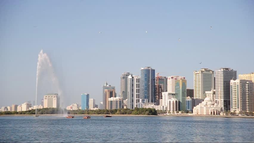 Beautiful view of Sharjah lagoone with big fountain, UAE.