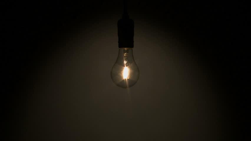 Light In Dark Room string lights in dark room, camera moving away stock footage video