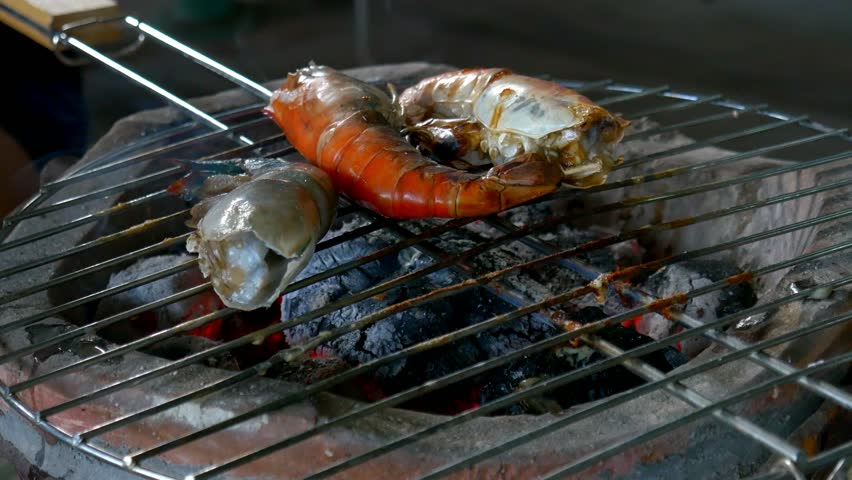 Grilled prawns on stove. | Shutterstock HD Video #34570918