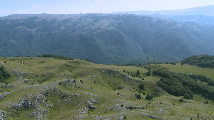 A spectacular aerial of green slopes of Dinaric Alps