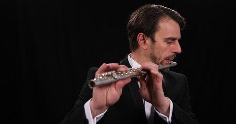 Portrait of Flutist Man Play Flute Classic Music Instrument Orchestra Audition